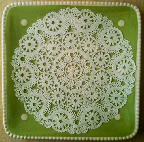 Green dotted plate with white doily for Easter Nests Candy