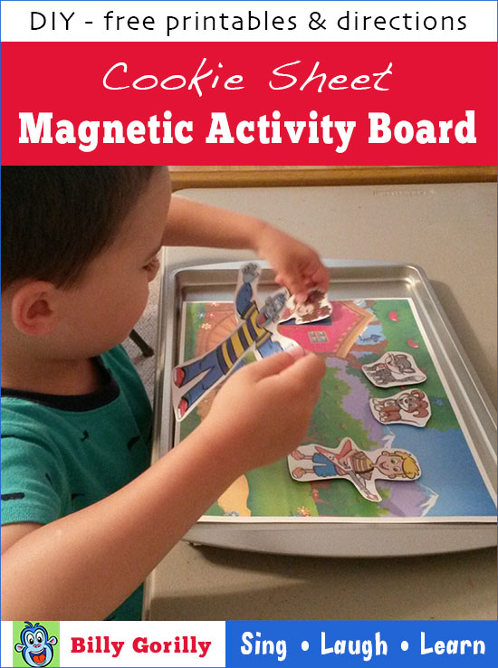 Boy playing with Billy Gorilly and friends on cookie sheet magnetic activity board